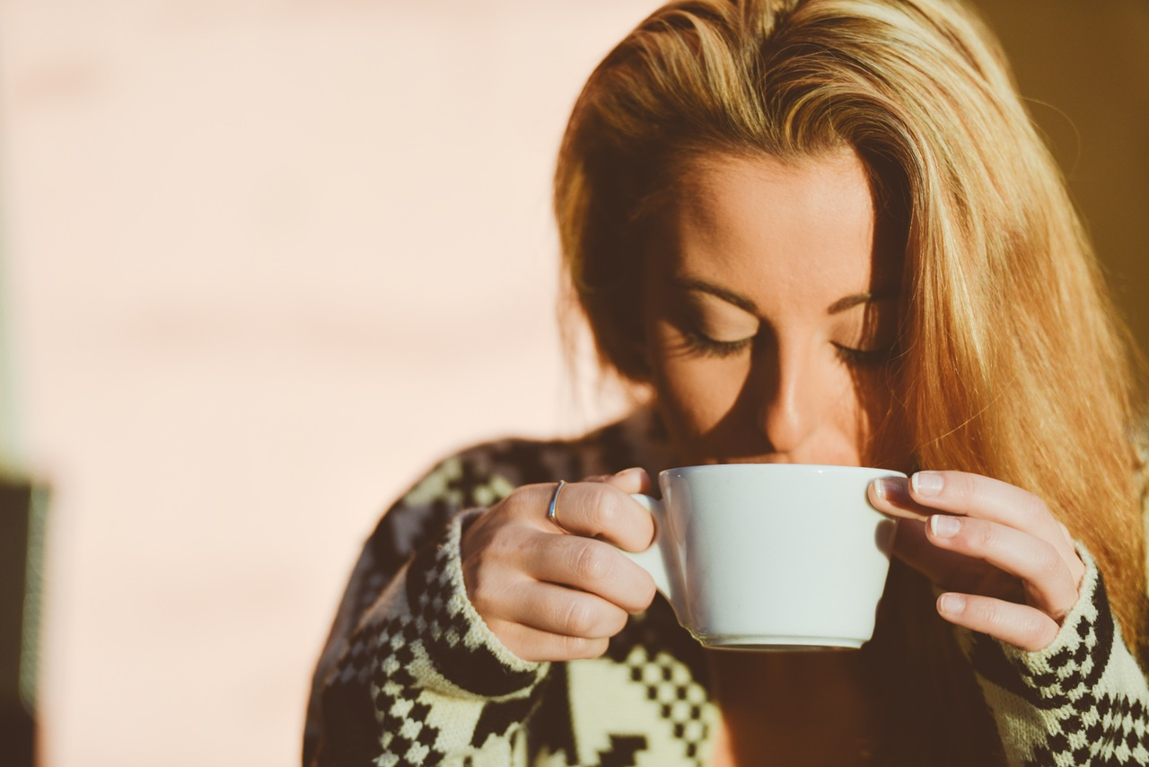 woman coffee tea cup immune system boosters